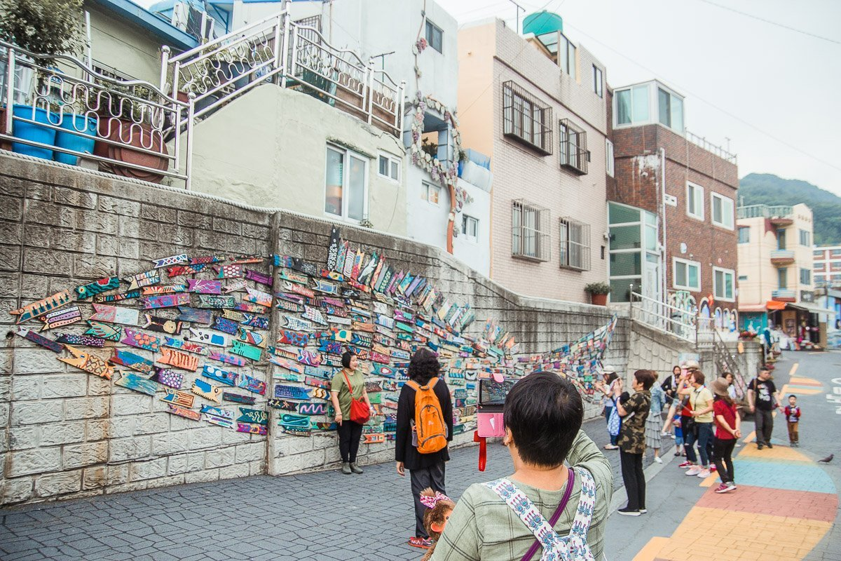 "Murals in Gamcheon Village On the same stretch, you will also see one of the famous murals in the village – ""Fish Swimming Through The Alley"" by Jin Yeongseop."